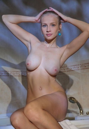 Busty model Penelope G wets her hard nipples & shaved beaver in the shower
