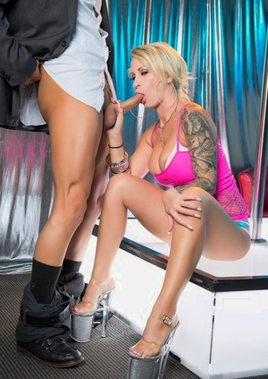 Inked blonde stripper Daisy Monroe sucks and pulverizes a big dick up on stage