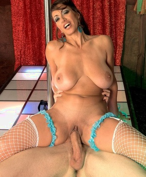Mature stripper Persia Monir seduces a younger guy with suggestive pole moves