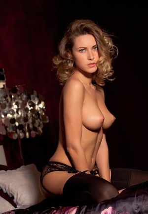 Sultry stripper Beau M peels black sheer lingerie and shows her perky nipples