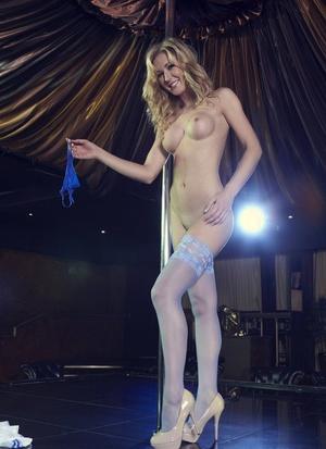 Blonde stripper Sam Tye peels off a sailor uniform up on stage
