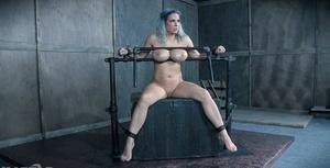 Naked female Alyssa Lynn has her large tits manhandled in bondage