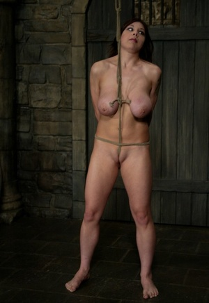 Busty redhead Mallory Knots is gagged and trussed with a rope before breast torture
