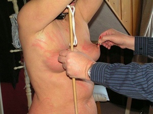 Naked female endures hardcore torture session at the hands of a sadist