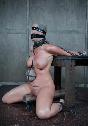 Busty gimp Syren De Mer strapped & lubed for torturous BDSM tit torture & spanking