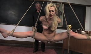 Female students at Kink University earn their degrees in rope suspension