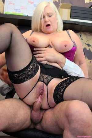 Hefty boobed granny sports a mouthful of jizz after anal sex in her office