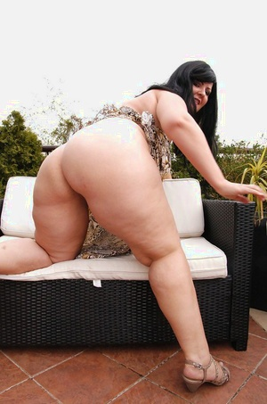 Obese black-haired mom Carmen Carlos revealing fur covered twat and big donk on patio