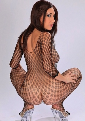 Brunette dame Eloa Lombard releases her big natural tits from a bodystocking