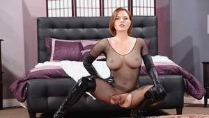 Ravishing redhead MILF posing in inviting nylon and spandex outfit