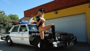 Blonde bombshell in police uniform stripping and toying her cunny outdoor