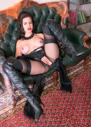 Classy female Tindra Frost shows her tits and twat in long footwear and nylons