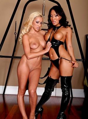 Asian babe Asa Akira and hot ash-blonde Breanne Benson in lesbian set
