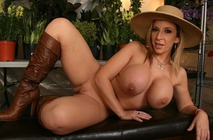 Blonde chick Sara Jay reveals her big ass in a straw hat and high heeled shoes
