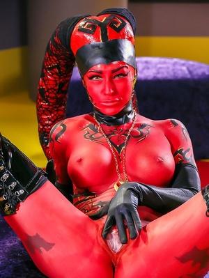 Cosplay model Kleio Valentien exhibiting pink twat in long latex boots
