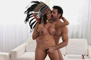 Mature woman in Native American attire has her hefty tits and twat fondled