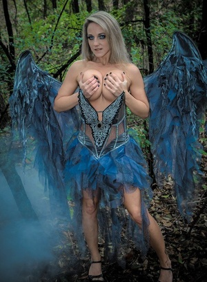 Fairy cosplay female Nikki Sims doffs her wings and wisp to stance in a thong