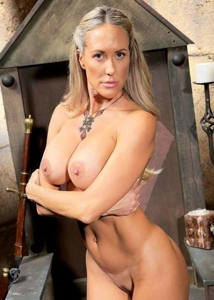 Mature blonde woman Brandi Enjoy frees her big tits from cosplay costume