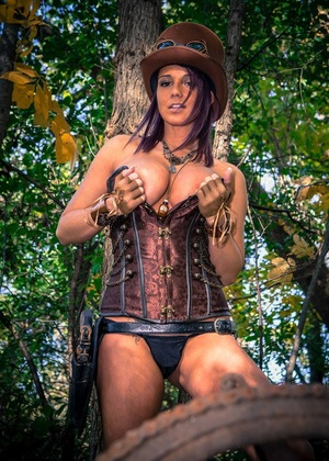 Amateur cosplay girl Nikki Sims in thong baring her firm boobs in the forest