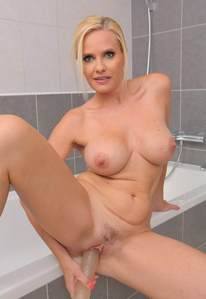 Giant titted hot blonde Mummy Lilly Peterson toys with huge fake penis in the tub