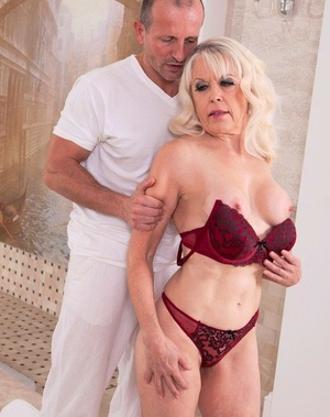 Hot ash-blonde granny Girl S seduces her masseur in red hooter-sling and panty set
