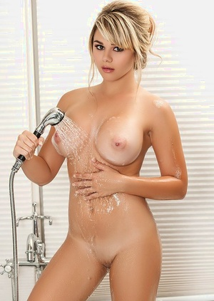 Centerfold babe Tahlia Paris baring yam-sized mounds and sexy ass in bathroom