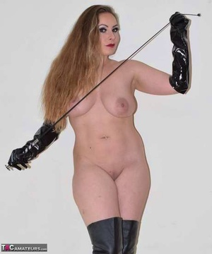 Amateur chick gets naked in thigh high leather footwear and long latex gloves