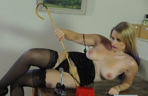 British Headmistress in black stockings is taken with her instruments of pain