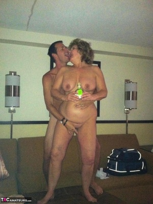 Horny granny BustyBliss oils up floppy mounds & spreads labia for hotel guy toy