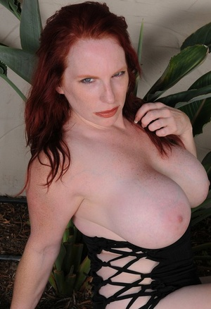Older redhead Red Vixen unveils her knockers prior to showing her pinkish twat