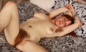 Hairy model Velma has legs that demand a hirsute woman lover's attention