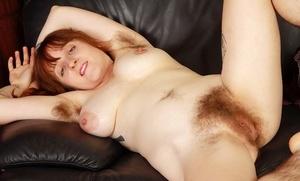 Experienced redhead Velma pulling undies aside to expose her vulva
