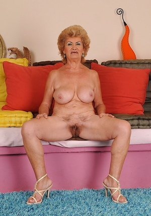 Juggy granny with ugly face stripping and expposing her shaggy cunt