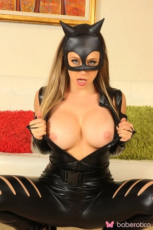 Blonde chick works clear of a cat suit before spreading her labia lips