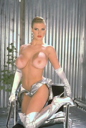 Vintage slut Brittany Andrews in silver lingerie & boots frees big tits to fucktoy