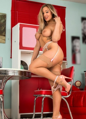 Attractive housewife spreads her legs and vagina at the kitchen table