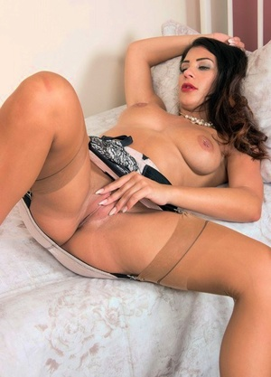 Fancy Roxy sheds her classy vintage clothing to stretched naked in stockings