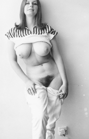 Busty vintage model lifts her dress to show big juicy melons & furry twat