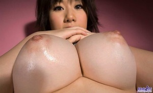 Japanese girl Hanno Nono fondles big naturals while getting mostly naked