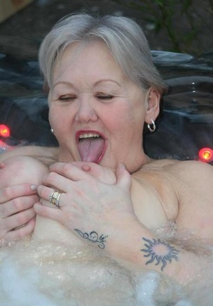 Old woman Valgasmic Exposed plays with her breasts while hot tubbing