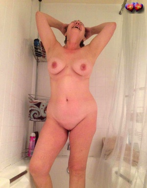 Older amateur Busty Bliss takes a shower after finger spreading her clean-shaven pussy