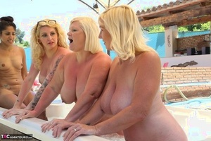 Nude mature Melody & her big-titted mates flaunting fatty ass in outdoor hot tub