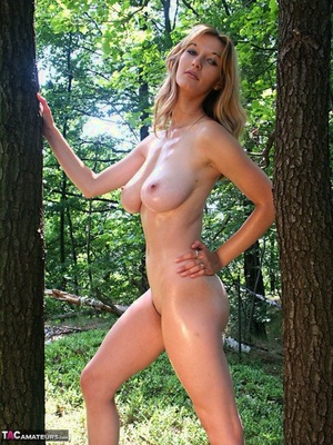 Hot blonde Vanessa removes bikini in the woods walking nude among the trees