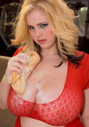 Large fatty Ashley Sage Ellison soaps up her massive big tits washing her car