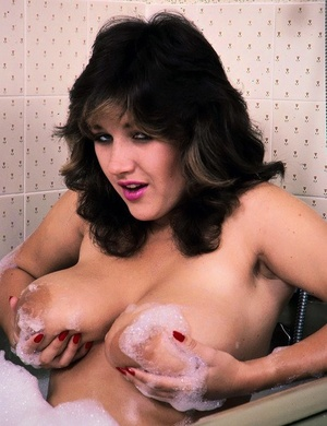 Solo model Stacy Owen flaunts her knockers in and out of the bathtub