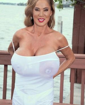 Older Asian chick Minka wets her massive breasts on harborside patio