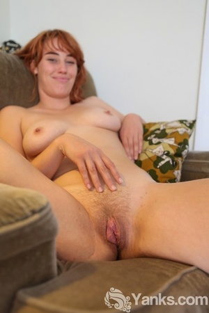 Redhead Molly Broad exposes her pink nipples on way to showing her hairy body