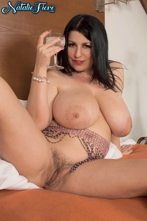 Sexy fatty Natalie Fiore covers her naked large big breasts in white cream