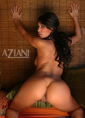 Alluring brown-haired beauty Sophia Lucci strips naked for nude solo poses