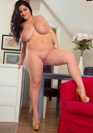 Chubby Belarusian woman Juliana Simms demonstrates huge boobs and fat bottom